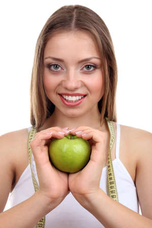 Beautiful girl with apple and measuring tape, isolated on white photo