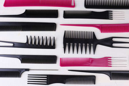 Professional hairdresser tools  on color wooden background photo