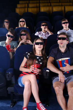 Young people watching movie in cinema photo