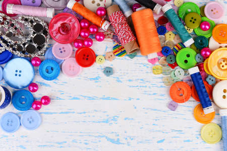 Sewing accessories on wooden table close-up photo