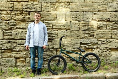 bmx bike: Young boy on BMX bike at park