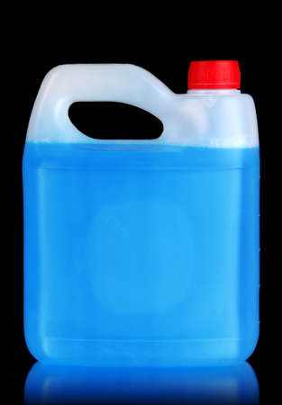 Blue liquid for car in canister on black background photo