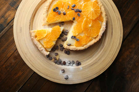 orange tart: Homemade orange tart with coffee grains on wooden background Stock Photo