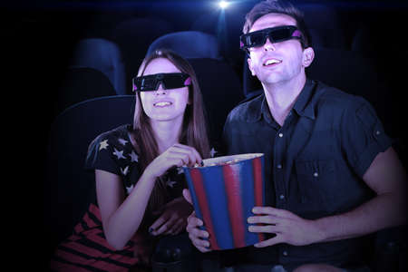 Young couple watching movie in cinema photo