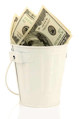 bucket of money: Money in  trash can, isolated on white