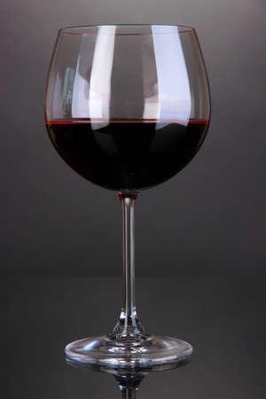 stemware: Red wine glass on grey background