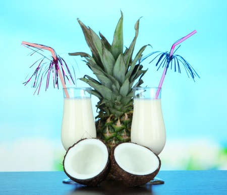 Pina colada drink in cocktail glass, on bright background photo