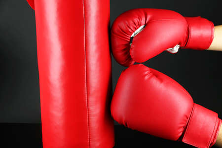 leatherette: Box training and punching bag, isolated on black Stock Photo