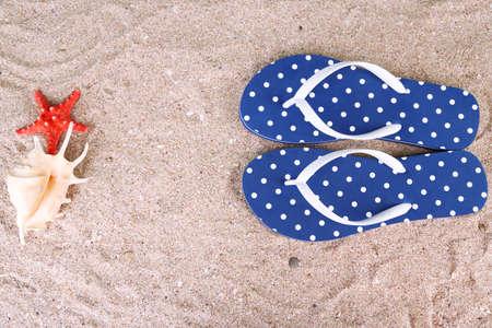 Color flip-flops on sand background photo