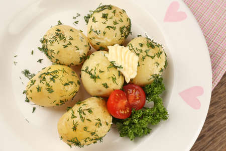 Young boiled potatoes on table, close up photo