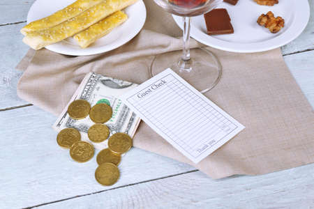 Check and remnants of food on table in restaurant  photo