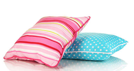 Blue and pink bright pillows isolated on white