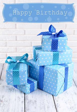 Beautiful gifts on brick wall background photo