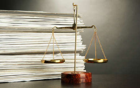 judicature: Gold scales of justice and folders on grey background Stock Photo