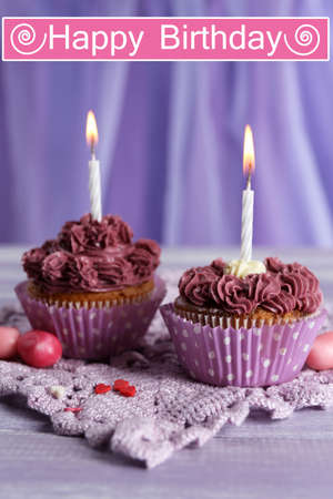 Tasty cupcakes on bright background photo