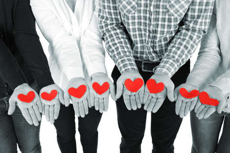 helping people: Hands with hearts, close up