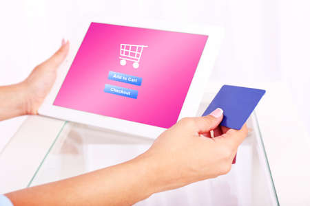 eshop: Concept for Internet shopping: hands holding tablet and credit card
