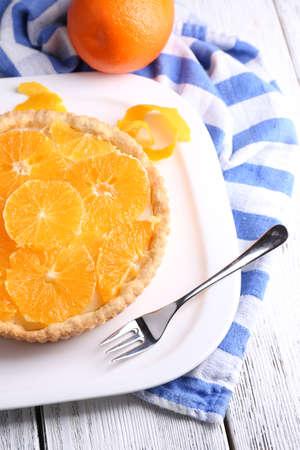 orange tart: Homemade orange tart on plate, on color wooden background Stock Photo