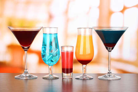 soft drinks: Several glasses of different drinks on bright background