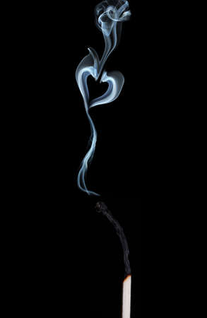 Abstract smoke in shape of heart on black  background photo