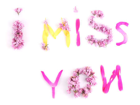 i miss you: I miss you laid out from petals and flowers  isolated on white