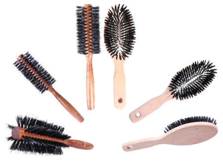 Collage of wooden hairbrushes isolated on white photo