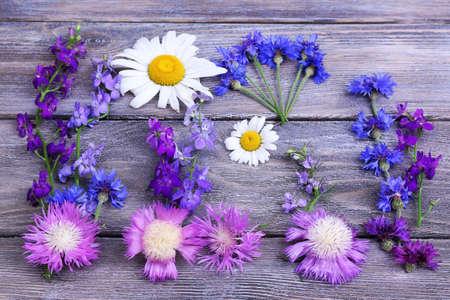 garden cornflowers: Beautiful wildflowers on wooden background
