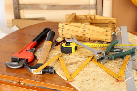 tinkering: Working tools on table, in workshop