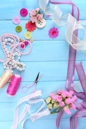 brads: Scrapbooking craft materials on color wooden background