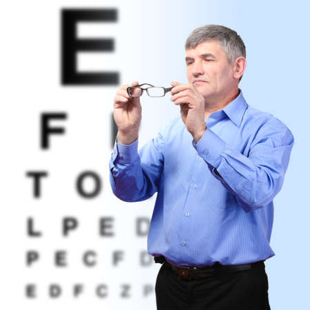 Medicine and vision concept - man with eye chart photo