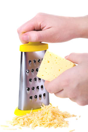 metal grater: Metal grater and cheese isolated on white Stock Photo