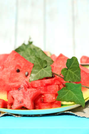 Fresh slices of watermelon on table, on wooden background photo