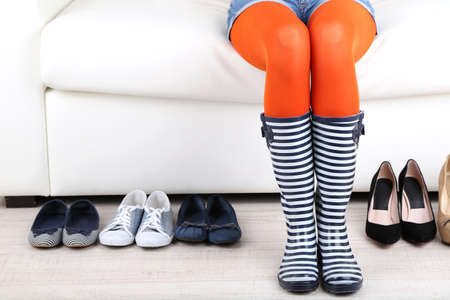 Perfect woman legs and different shoes, close up Stock Photo