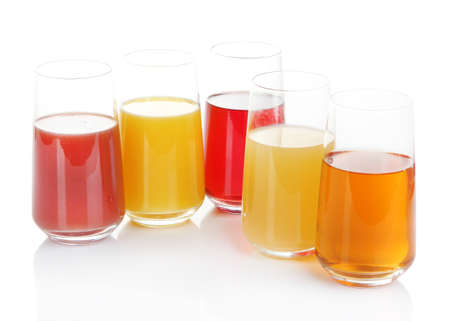 Variety of juices in glasses, isolated on white photo