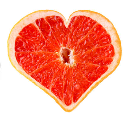 Grapefruit in shape of heart, isolated on white photo