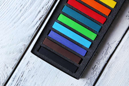 white chalks: Colorful chalk pastels in box on wooden background Stock Photo