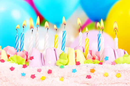 Birthday cake with candles on bright background photo