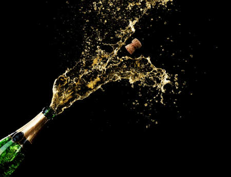 Champagne splashes on black background photo