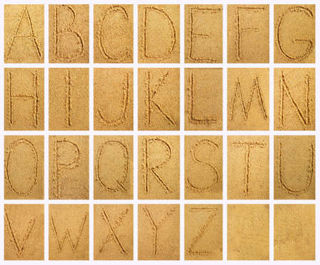 wet: Handwritten alphabet letters on sand background