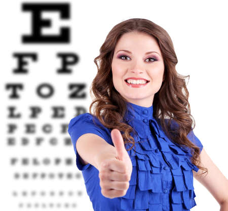 Medicine and vision concept - woman with eye chart photo
