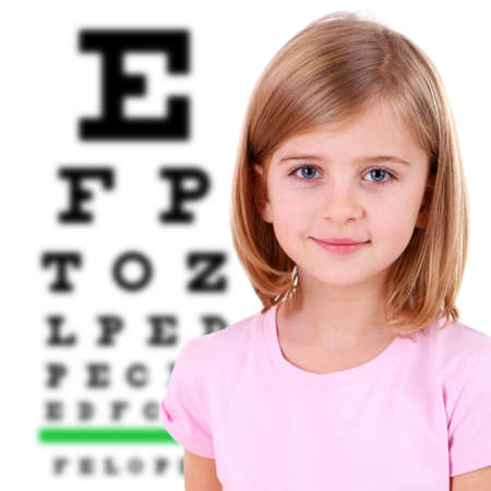 Medicine and vision concept - little girl with eye chart photo
