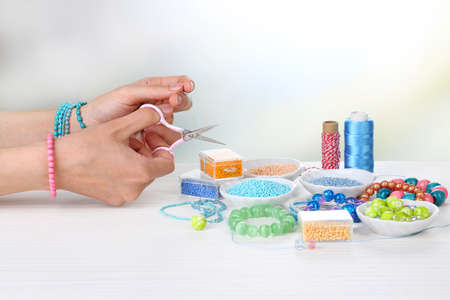 Process of creating costume jewelry close-up photo