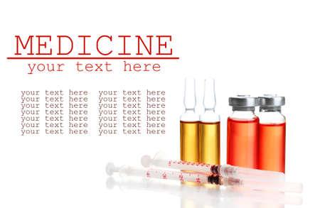 Medical ampules and syringes, isolated on white photo