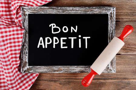 bon: Bon appetit written on chalkboard, close-up Stock Photo