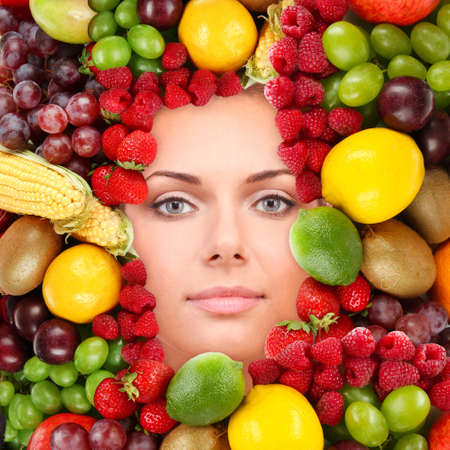 Woman beauty face with fruits frame, close-up photo