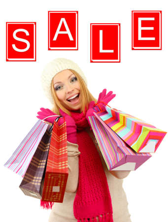 Concept of discount. Attractive young woman with shopping bags, isolated on white photo