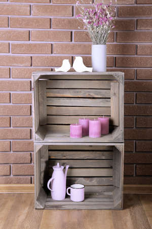 stand teapot: Shelves made of wooden boxes for small things for home Stock Photo