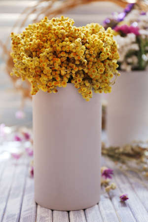 Beautiful flowers on table at home photo