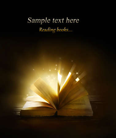 Magical book on bright background photo