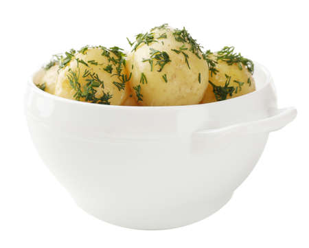 Young boiled potatoes in bowl, isolated on white photo